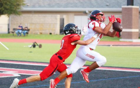 Junior cornerback Adam Eschler dives while playing defense on Frisco Centennial's number seven. The touchdown pass was incomplete.