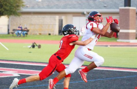 Junior cornerback Adam Eschler dives while playing defense on Frisco Centennial