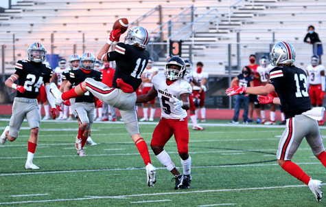 Senior safety Chief Collins elevates to intercept a pass from John Paul II