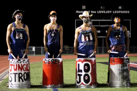 Senior Gavin Goodrich, junior Derek Dang, senior Sam Clay, and senior Peter Godipelly are four out of the five Dirty Drumline members this year. Besides senior Triton Freels, the four led the students at the football scrimmage yesterday.