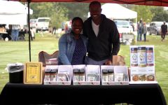 Abena and Eugene Opokua stand behind their spices at their booth at the Lucas Farmer's Market. The couple sell spices based out of Ghana West Africa that she has created.