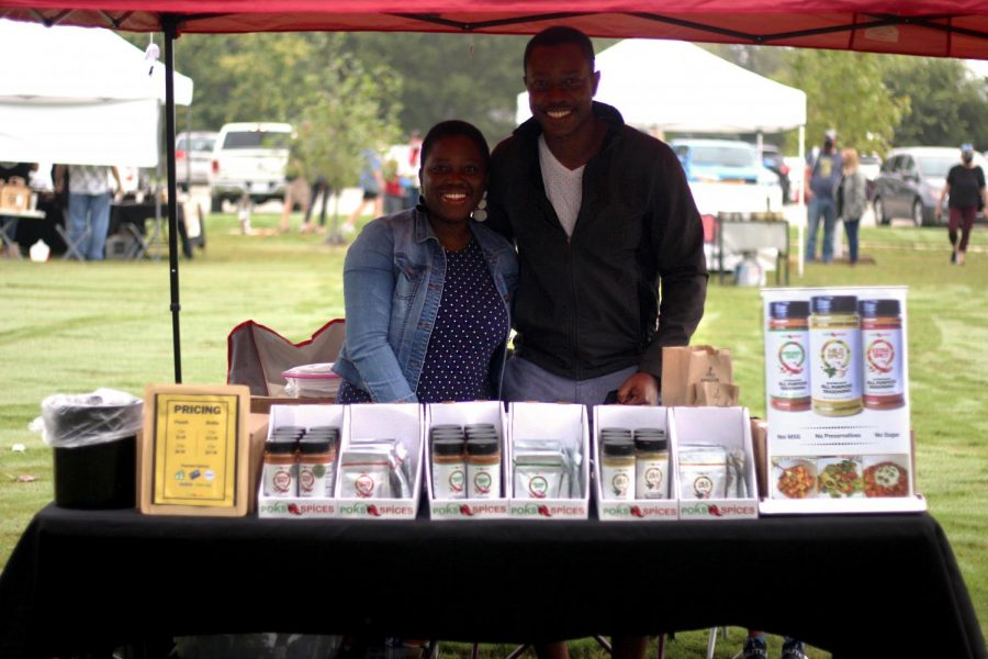 Abena and Eugene Opokua stand behind their spices at their booth at the Lucas Farmer