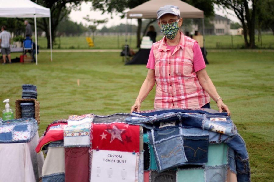 Kay+Montgomery+stands+with+her+custom+jean+quilts.+She+uses+old+worn+out+jeans+to+create+quilts%2C+potholders%2C+and+other+items.+