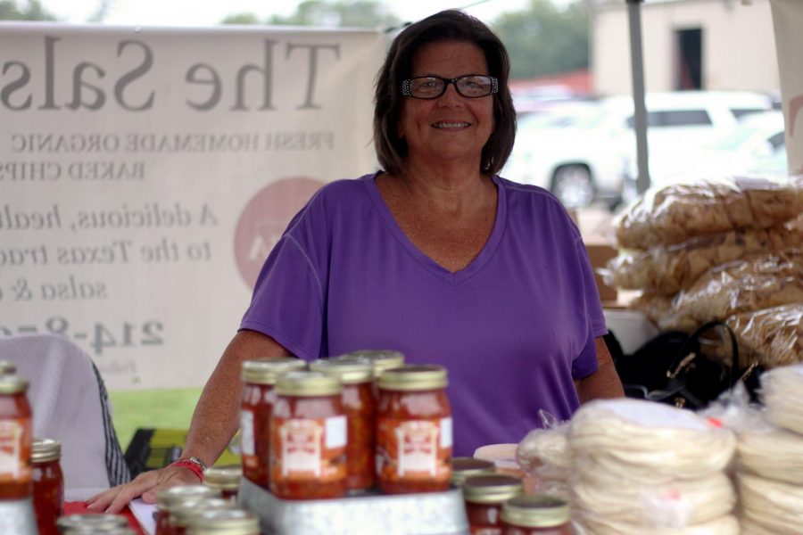 Stephanie+Canada+stands+behind+The+Salsa+Texan%27s+products+for+sale+at+the+Lucas+Farmer%27s+Market.+She+is+one+of+a+few+sales+representatives+around+the+area+for+The+Salsa+Texan.