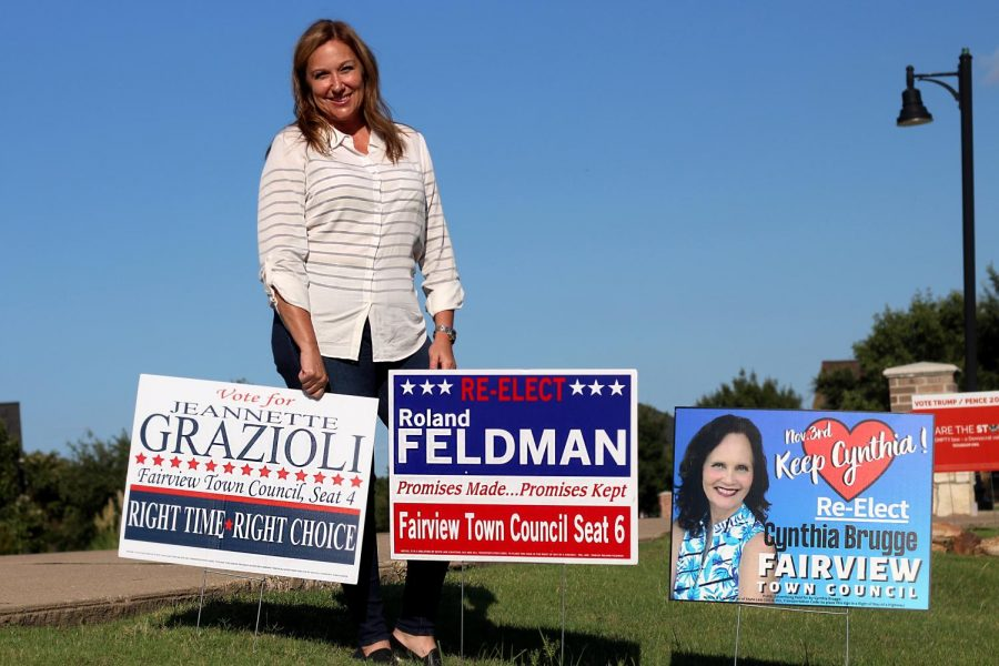 Jeanette Grazioli stands with her campaign sign along with the signs of incumbents Roland Feldman and Cynthia Brugge. Grazioli is a Lovejoy mom of junior, Gabby Grazioli, and eighth-grader, Will Grazioli.