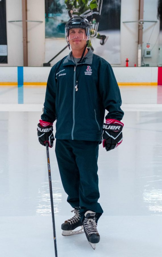 Coach Jason Day stands in his hockey gear. Day is coaching the Leopard's for his second season.