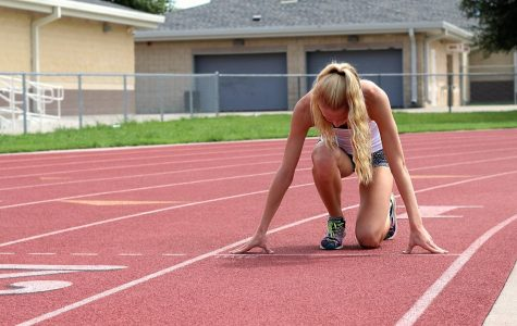 Freshmen Kailey Littlefield prepares for a run. Littlefield attended the Amateur Athlete Union this past summer.