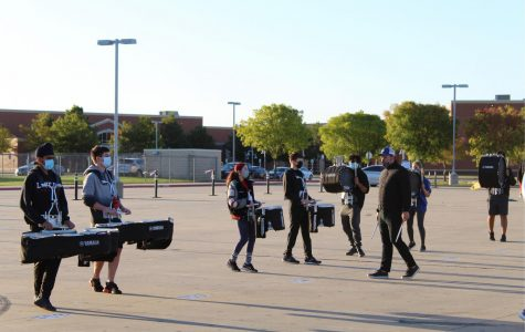 Lovejoy percussion group practices with the band and color guard in the morning.  Charis Vela is the section leader for the percussion group.