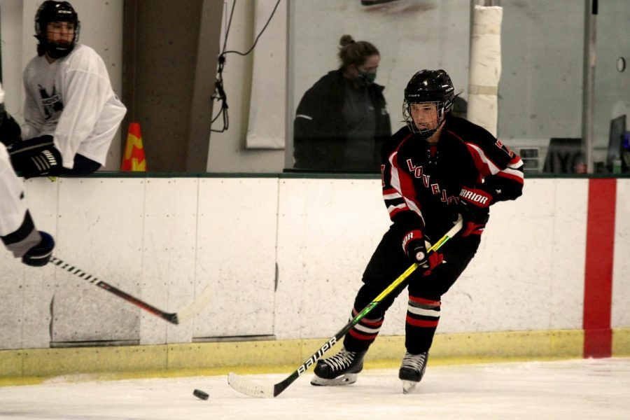 Sophomore+Jake+Scanlon+moves+the+puck+across+the+ice.+Scanlon+also+plays+for+the+Dallas+Penguins+junior+hockey+team.