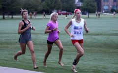 Sophomore Amy Morefield and freshmen Sara Morefield and Kaley Littlefield run at practice. The cross country team will compete at the Keller Invitational on Oct. 3.