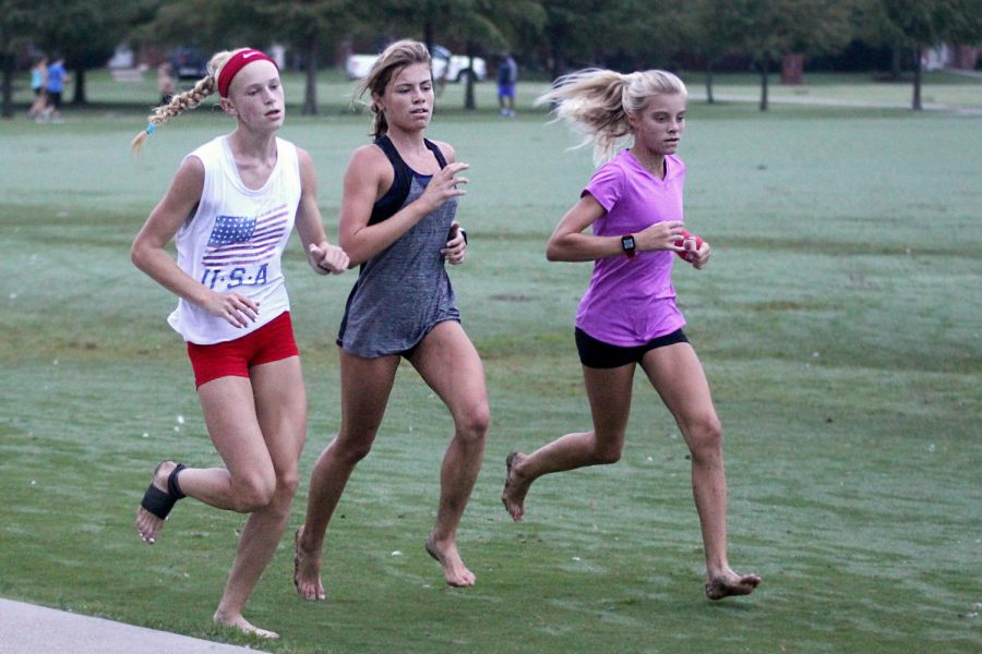 Freshmen Kailey Littlefield and sophomore Amy Morefield run around Celebration Park. Littlefield competed in one of the most competitive track meets in the country this last summer.