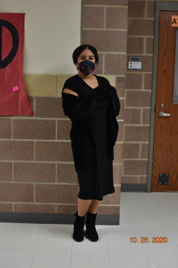 Sophomore Katy Nuckels wears all black including her black mask. Students, including Nuckels, dressed up to show school spirit.