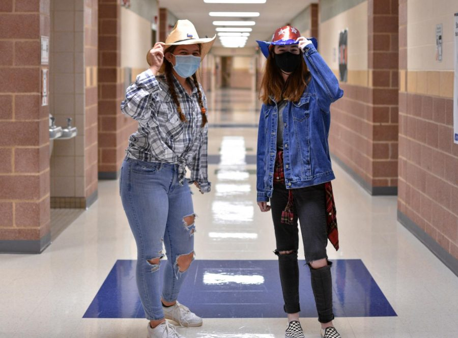 Sophomores Savannah Starr and Jillian Nuckels hold their cowboy hats. Thursday dress up theme is throwback.