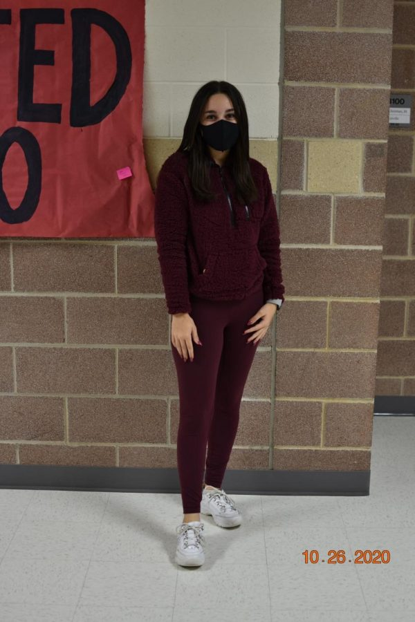 Sophomore Alexa Adam participates in the first theme day of homecoming week. Adam wears burgundy to show school spirit.