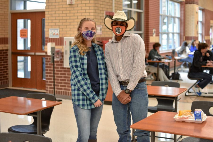 Junior Makenzie Aubel and senior Peter Godipelly pose in their western attire. Godipelly won Mr. Most Spirited at the pep rally yesterday.