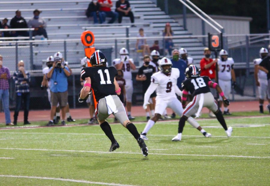 Senior Chief Collins runs an the ball after he caught an interception. Princeton threw two interceptions in the game.
