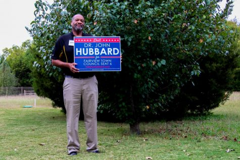 Dr. John Hubbard holds his campaign sign. Hubbard is running against Roland Feldman for Seat 6 of Fairview Town Council.