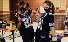 Sophomore Katy and Gillian Nuckels twin in their Dallas Cowboys jersey. Many Cowboys jerseys were worn for this dress up day.