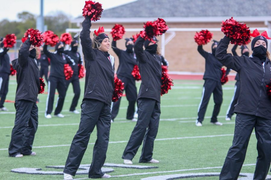 Senior+cheer+captain+Elle+Brumley+does+the+leopard+rumble+at+the+beginning+of+the+pep+rally.+This+was+the+first+time+Lovejoy+has+hosted+a+community+pep+rally+outdoors.