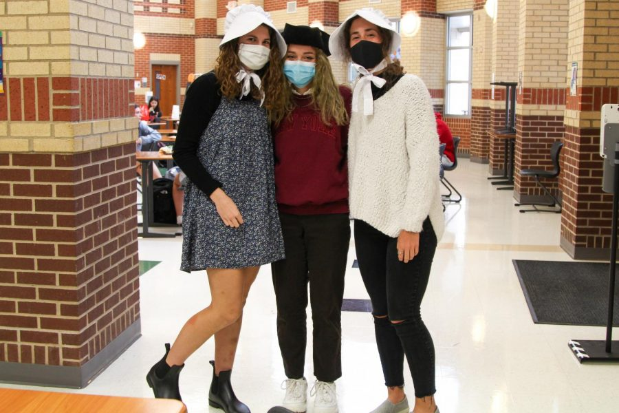 Juniors Mia Chase, Abby Carraway, and Eliza Coit dressed in colonial themed clothes. The groups outfits were themed the farthest back for Throwback Thursday.
