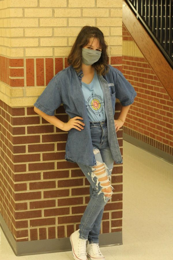 Junior Kendall Hartness poses in her all blue outfit. Hartness participates in dress up days every year.