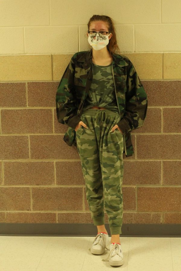 Sophomore Audrey Harper wears all camo to show school spirit. Along with all one color, students wore all one pattern for Monochrome Monday.
