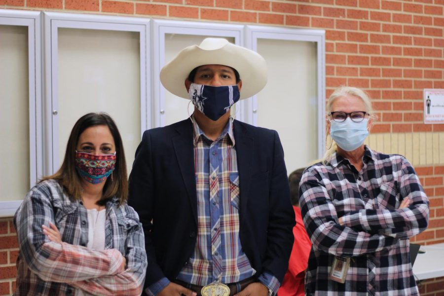 Julie Hirsh, Joel Ledezma, and Michelle McClelland wear western attire. McClelland is one of the cheer sponsors.