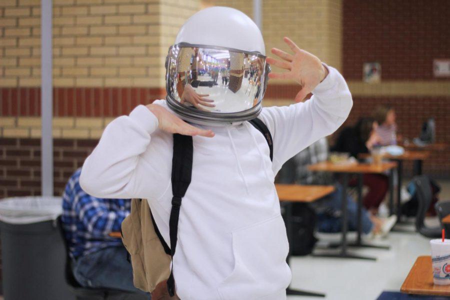 Senior Lee Kinnebrew poses in his astronaut helmet. Kinnebrew is part of the high school band.