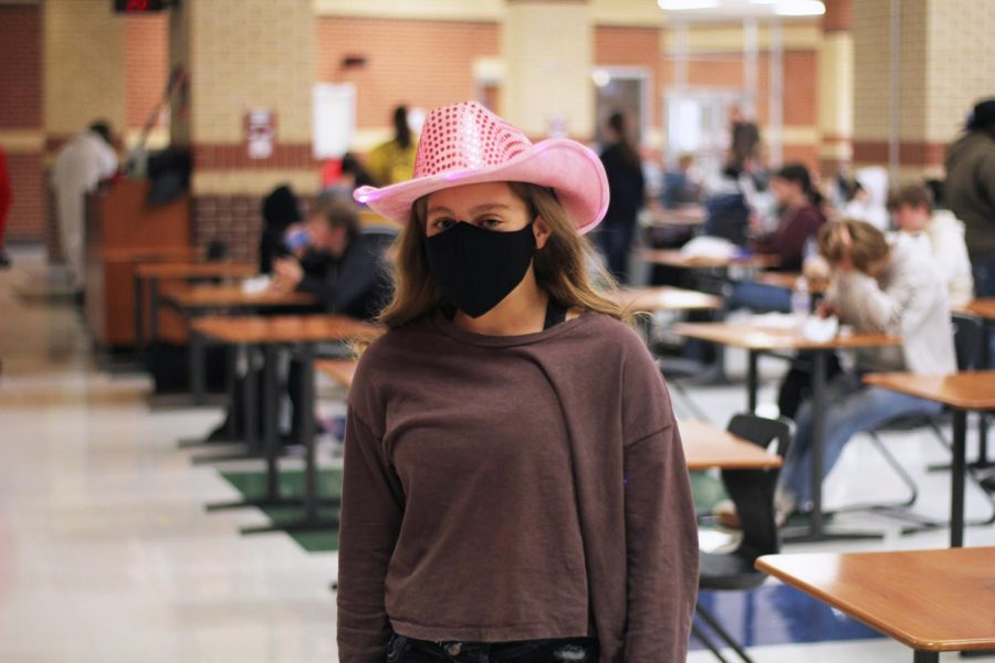 Freshmen Grace Johnson wears a sparkly pink cowboy hat. Johnson was one of a few students wearing this hat.