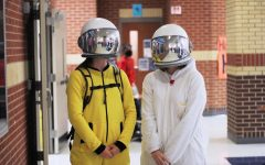 Seniors Alex Perry and Rachel Drew wear 'Among Us' themed space costumes. Their costumes featured astronaut helmets.