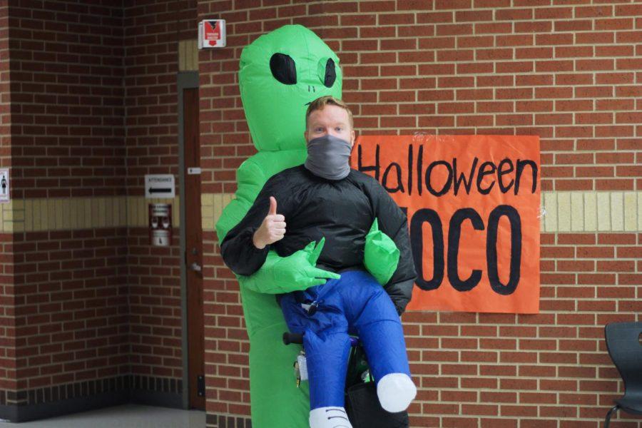 Jared Glaze wears a blow up alien costume. Glaze is one of the CAT teachers.