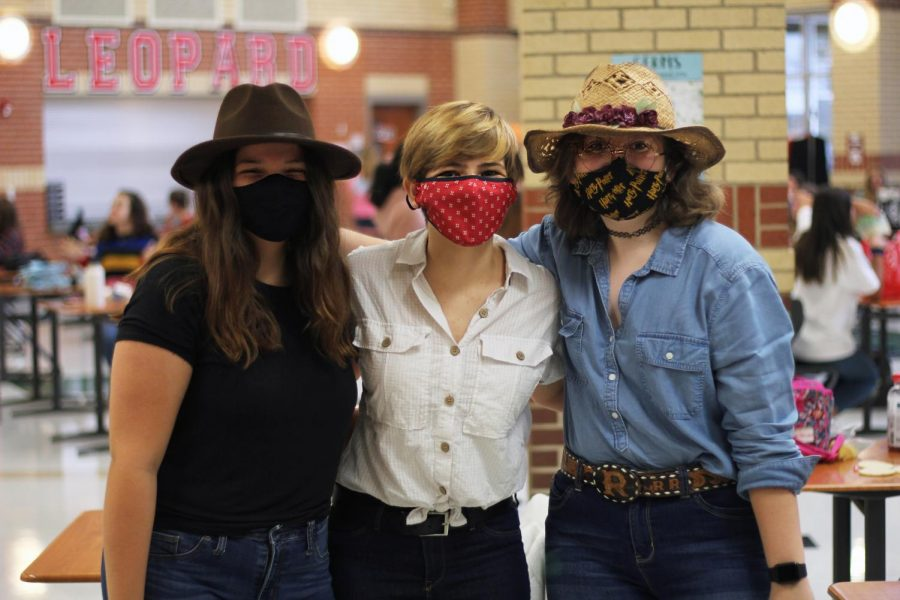 Sophomore Grace Hulbert, senior Anna Hulbert, and freshmen Caelyn Lee pose in their western wear. Western attire was the most common clothes for this theme day of Cowboys and Space..