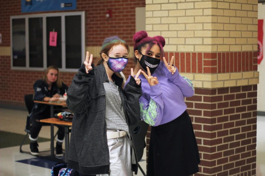 Freshmen Chloe Russell and sophomore Katie Nuckels wear space themed clothes. Nuckels also wears space buns in her hair.