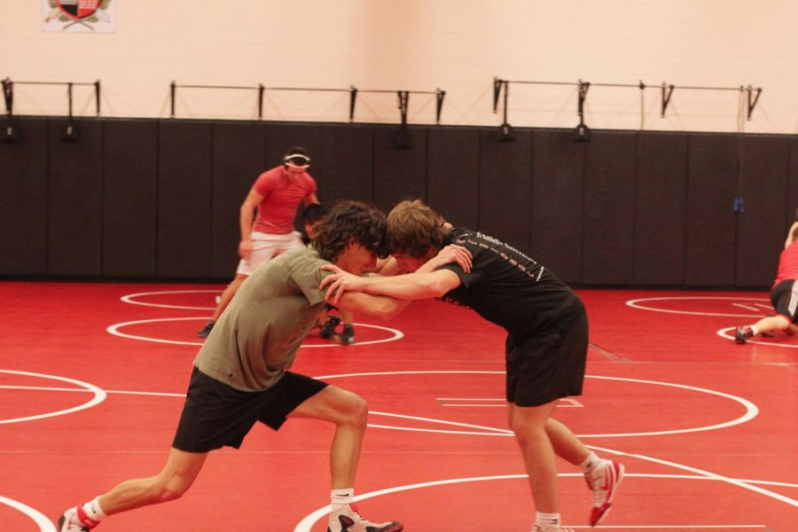 Seniors Jack McKinney and Dalton Braun practice by doing a wrestling drill. The wrestling teams duel and tournament season starts next semester.
