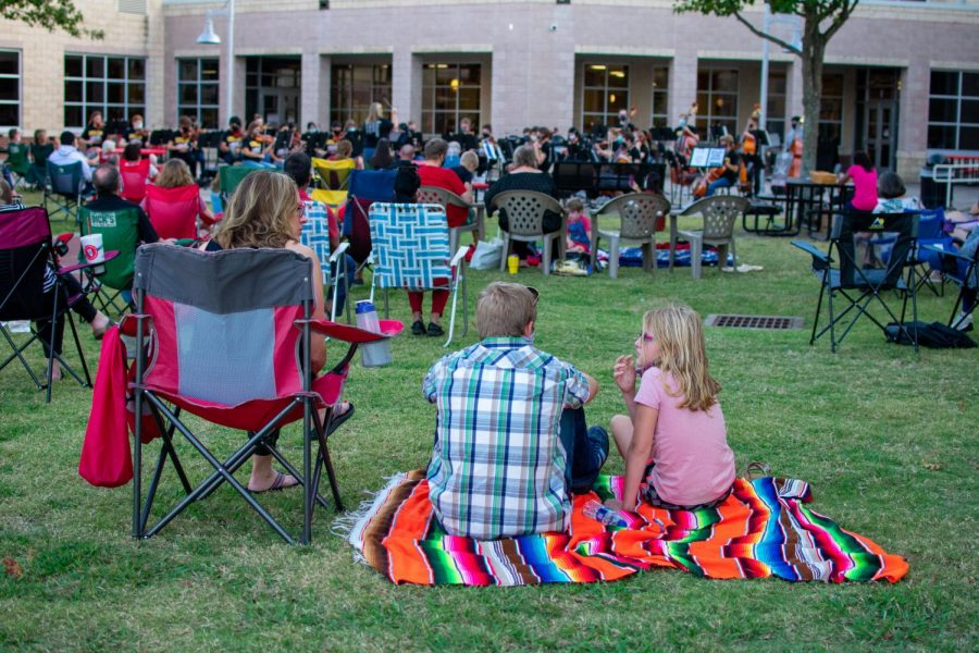 A family sits together to listen to the concert. Parents, siblings and grandparents attended to watch their family members perform.