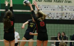 Senior Brynn Egger blocks the ball after an attempted spike onto the Leopards. Egger plays as a middle for Lovejoy.