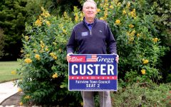 Gregg Custer holds his campaign sign. He is one of six Fairview citizens running for town council.