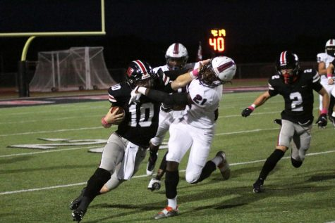 Senior Ralph Rucker runs past a Princeton defensive player. Rucker is the starting quarterback for the Leopards.