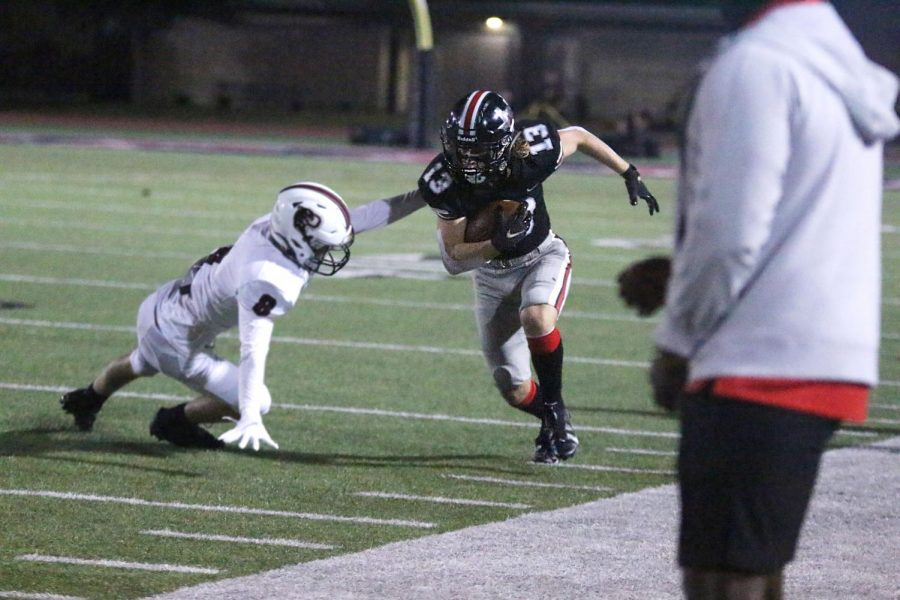 Senior Luke Mayfield runs the ball along the side of the field. Mayfield is the starting wide receiver for the Leopards.