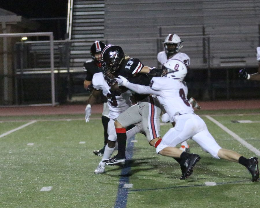 Senior Luke Mayfield runs through Princeton's defense. Mayfield's older brother is one of the coaches for the Leopards.