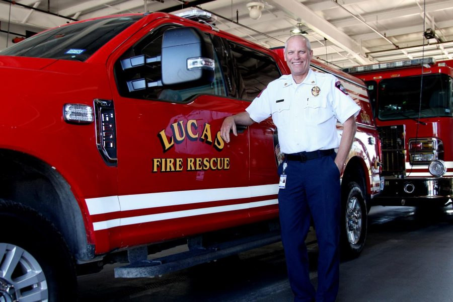 Lucas+fire+chief+Ted+Stevens+stands+with+one+of+their+trucks+at+the+station.+Stevens+was+previously+a+high+school+business+teacher+for+18+years.+