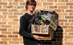 Senior Braden Schlimme holds his box of donated eyeglasses that he has collected for Lions Clubs International. People around the community have donated used prescription glasses to his cause.