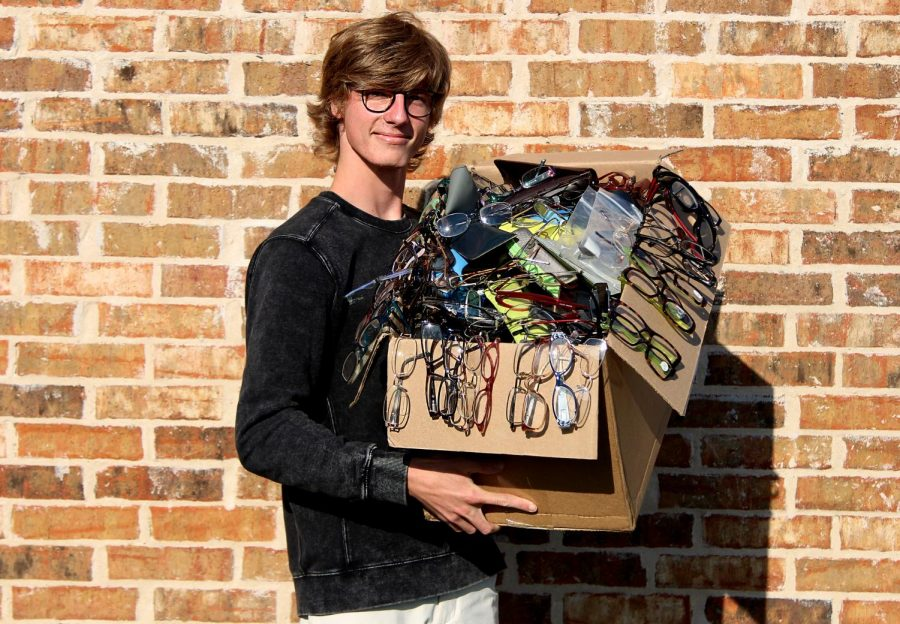 Senior+Braden+Schlimme+holds+his+box+of+donated+eyeglasses+that+he+has+collected+for+Lions+Clubs+International.+People+around+the+community+have+donated+used+prescription+glasses+to+his+cause.+