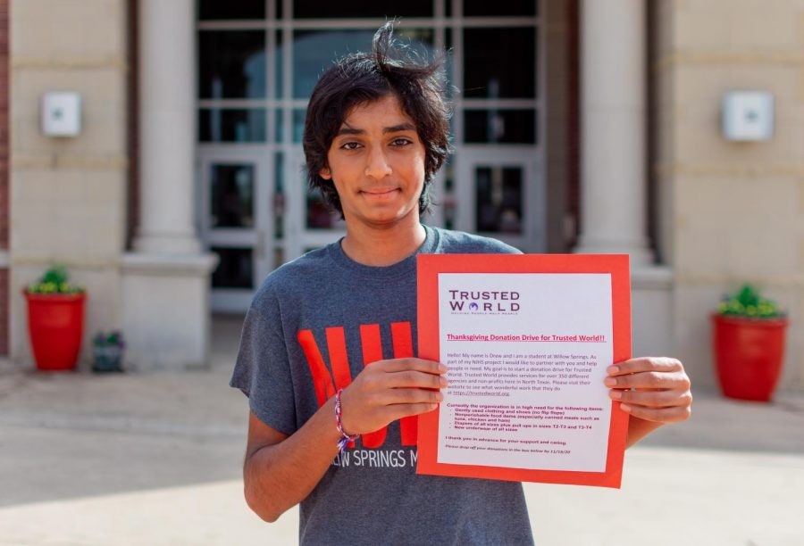 Eighth-grader Drew Mori holds up his flyer for his thanksgiving drive. Mori created this drive to give donations to Trusted World.