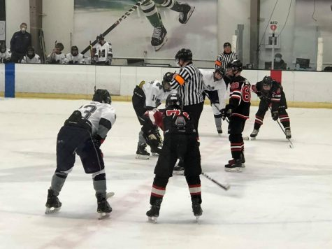 The hockey team lines up for a face off in their game against McKinney. Lovejoy won this game 3-0.