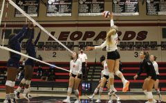 Senior Ellie Jonke hits the ball for the return. The return won the point for the Leopards.