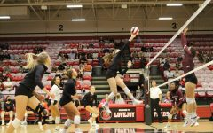 Senior Lexis Collins makes the return with a soft hit. The Leopards won the point after a long volley.
