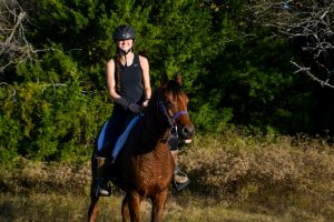 Senior Anna Iovinelli rides in on her horse after an eight mile ride. Iovinelli rode in the Trace the Trail competition.