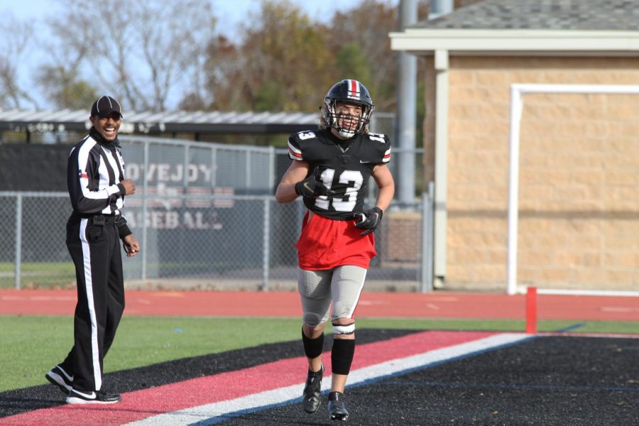 Senior wide receiver Luke Mayfield smiles with the referee after scoring a touchdown. The Leopards covered a total of 578 yards throughout the game.