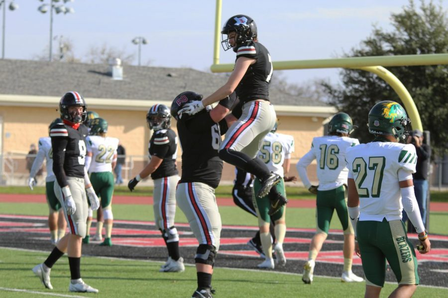 Senior wide receiver Reid Westervelt and senior center Trent Robinson celebrate after Westervelt scored a touchdown. The Leopards will play Frisco Liberty on Dec. 3.